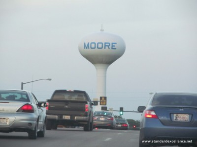 Water tower behind traffic in Moore, Oklahoma